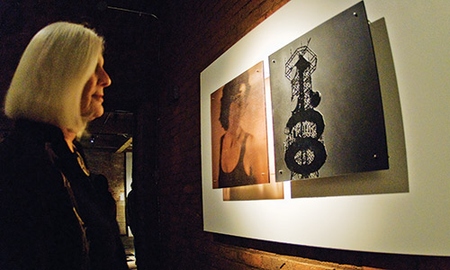A woman admires a piece on view at Bullseye's fine arts gallery in Portland.