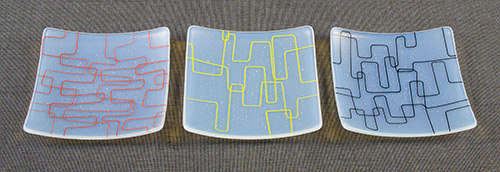 examples of finished slumped plates with fine line stringers