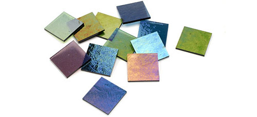 small squares cut from a piece of rainbow iridescent sheet glass